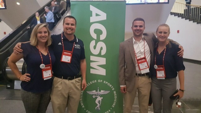 Megan Mormile, left, Nicholas Murray, Ph.D., Nathan D'Amico and Katelyn Grims attended the American College of Sports Medicine annual meeting in Boston.