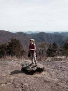 """Dr. Shauna Joye, assistant professor of psychology at Georgia Southern University, stops for a picture at the top of Blood Mountain in northern Georgia. Joye and a team of researchers have partnered with Warrior Hike """"Walk Off The War"""" Program, to study thru-hiking – walking an entire long-distance trail in one attempt – as an alternative method of therapy for combat veterans suffering from post-traumatic stress disorder."""