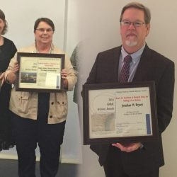 Sue Moore, Ph.D., left, and Johnathan M. Bryant, Ph.D., stand after being recognized at the Georgia Historical Records Advisory Council's 14th Annual Archives Awards.